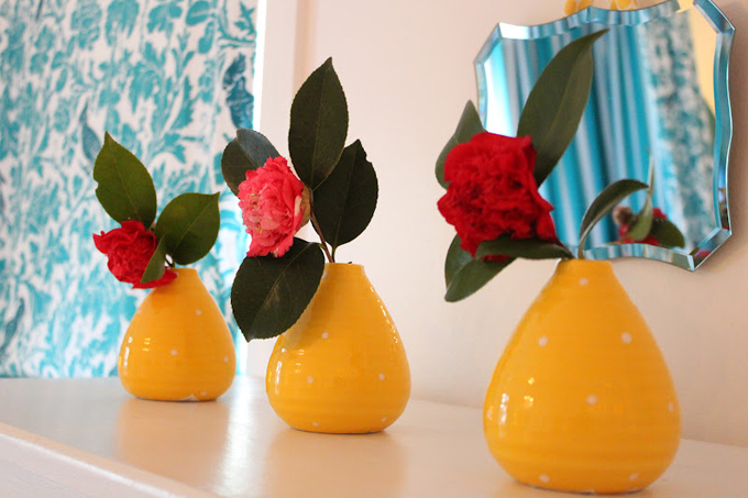 turquoise wall paper yellow vases