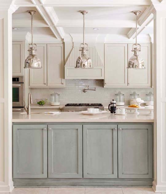 Kitchen with subway tile backsplash, silver pendant lights, aqua cabinets, glossy counters and stainless appliances