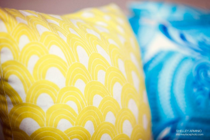 turquoise and yellow throw pillows
